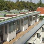 Aufstockung Mehrfamilienhaus in München - viel Licht durch großzügige Fensterfronten