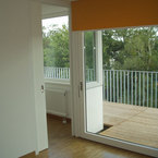 Aufstockung Mehrfamilienhaus in München - Parkettboden im Wohnbereich