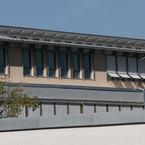 Welfen-Gymnasium in Schongau - höhenversetztes, gegenläufiges Pultdach mit Lichtband