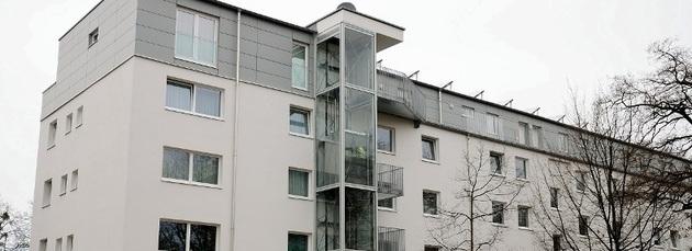Holzbau als Gebäudeaufstockung einer Wohnanlage in München